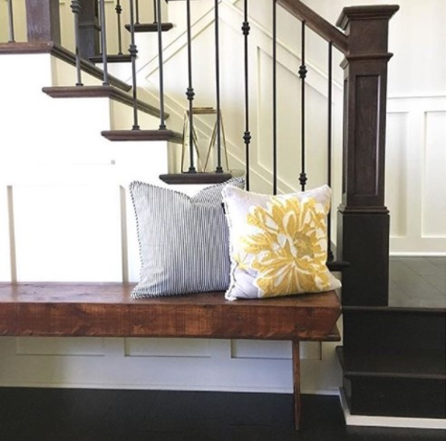 Modern farmhouse entryway with wainscoting and neutral colors.