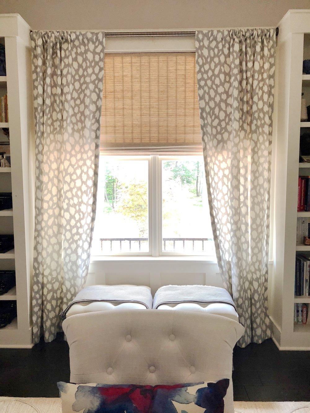 Layered custom window treatments by Calico featuring Kate Spade LeoKat fabric and Hunter Douglas shade.