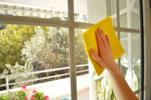 bigstock-a-Woman-cleaning-a-window-in-s-42222061-600x399.jpg