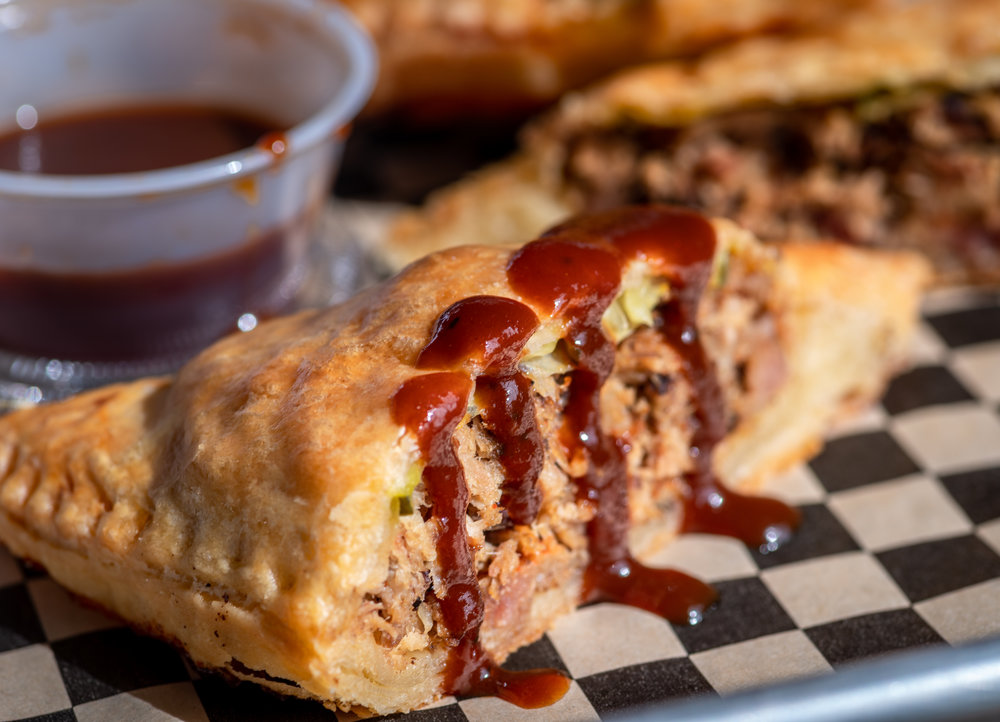 New special! Mag-Pies! Single serving sized meat pie filled with our pulled pork, Big Stick BBQ Sauce, pickles and onions $4