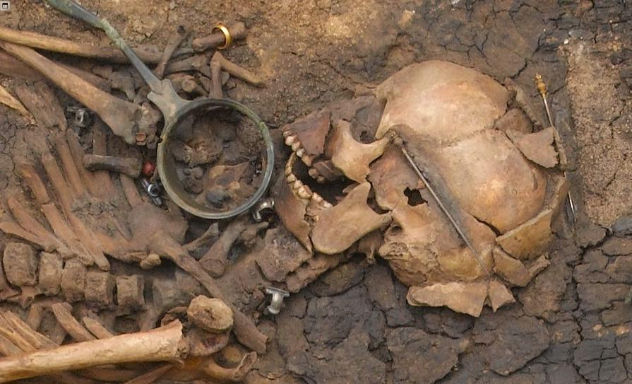 at juellinge in denmark, this roman era woman was laid to rest with roman drinking vessels and a strange concoction.