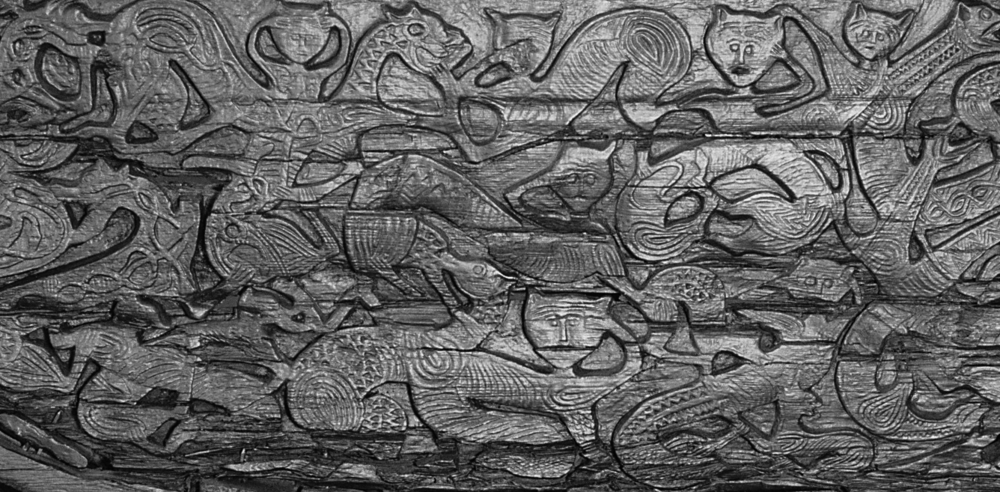 Carved panel depicting feline creatures on the 9th century Oseberg Wagon. Photo: KHM, UiO