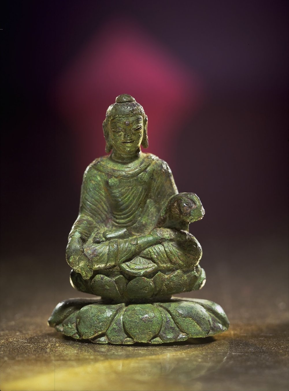 The Helgö Buddha. Photo: Historiska Museet