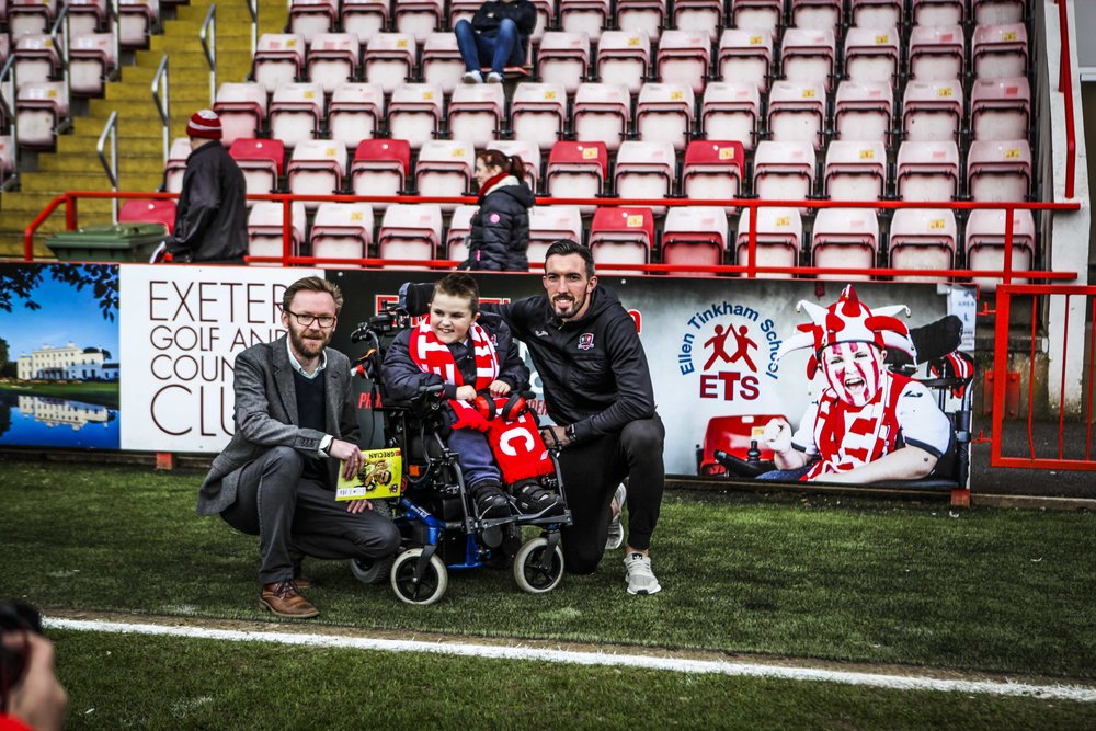 Owen pictured with Ellen Tinkham Deputy Head Simon Winward and Exeter City FC player Ryan Bowman