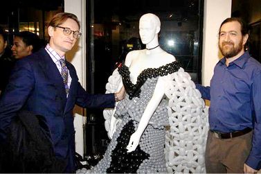 Hamish Bowles European Editor at Large for Vogue & Larry Moss pose with the dress sculpture