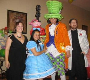 Alice and the Mad Hatter played by Jacqueline Hernandez and Sheldon Blake. Also pictured, designers Larry Moss and Kelly Cheatle.