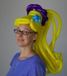Jan Spagnola wears a wig by Debbie Stevens.