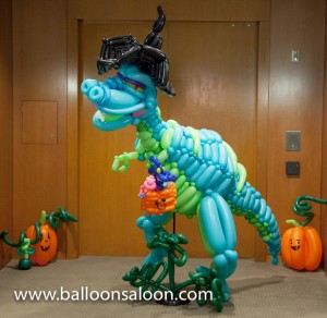 Trick-or-treat balloon dinosaur witch