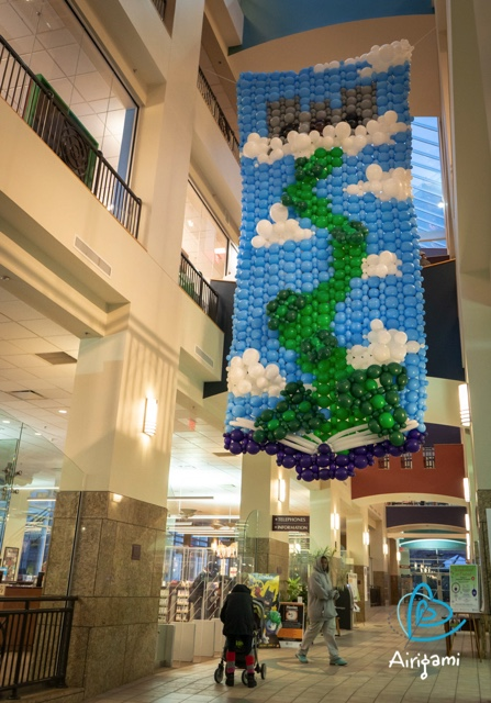 This Airigami Bubble Mural™ was constructed by the attendees of Maker Faire Rochester and hung in the Central Library of Rochester for the month of December. This depiction of Jack's beanstalk rising out of a library book is just the first Airigami mural to be displayed in this location.