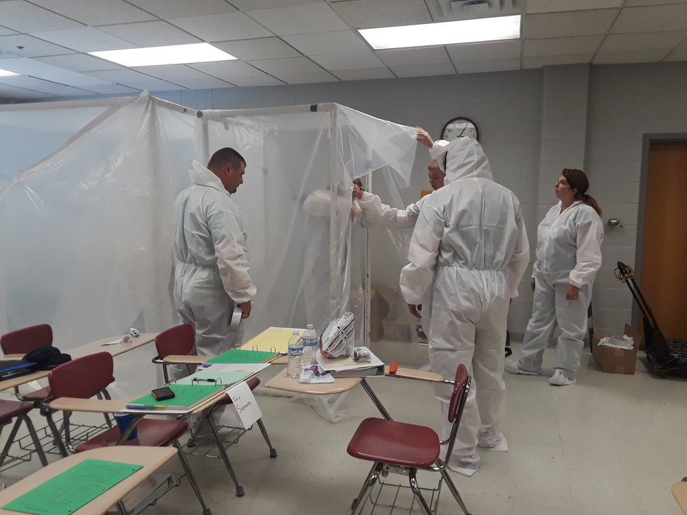 (Pictured [l to r]: Tony Sizemore, John West, Jesse Brock, Jordan Jackson, Marsha Griffey. Not pictured Darren McQueen. All six trainees passed their exam and are now certified as Asbestos Mitigation Supervisors.)