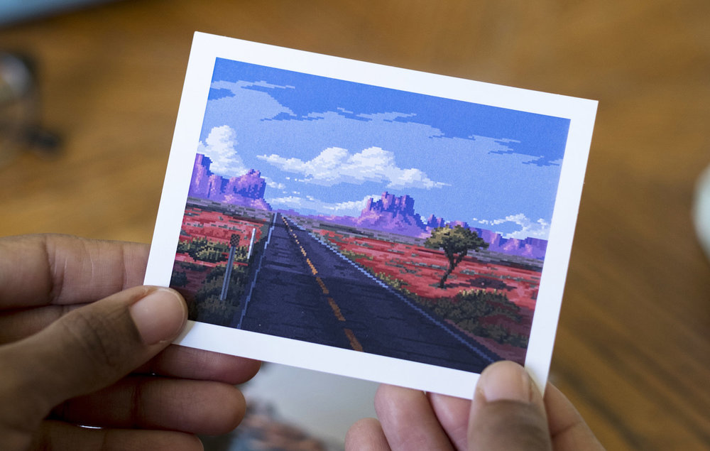 Pixel art by @kldpxl depicting a desert highway scene was included in the letter.