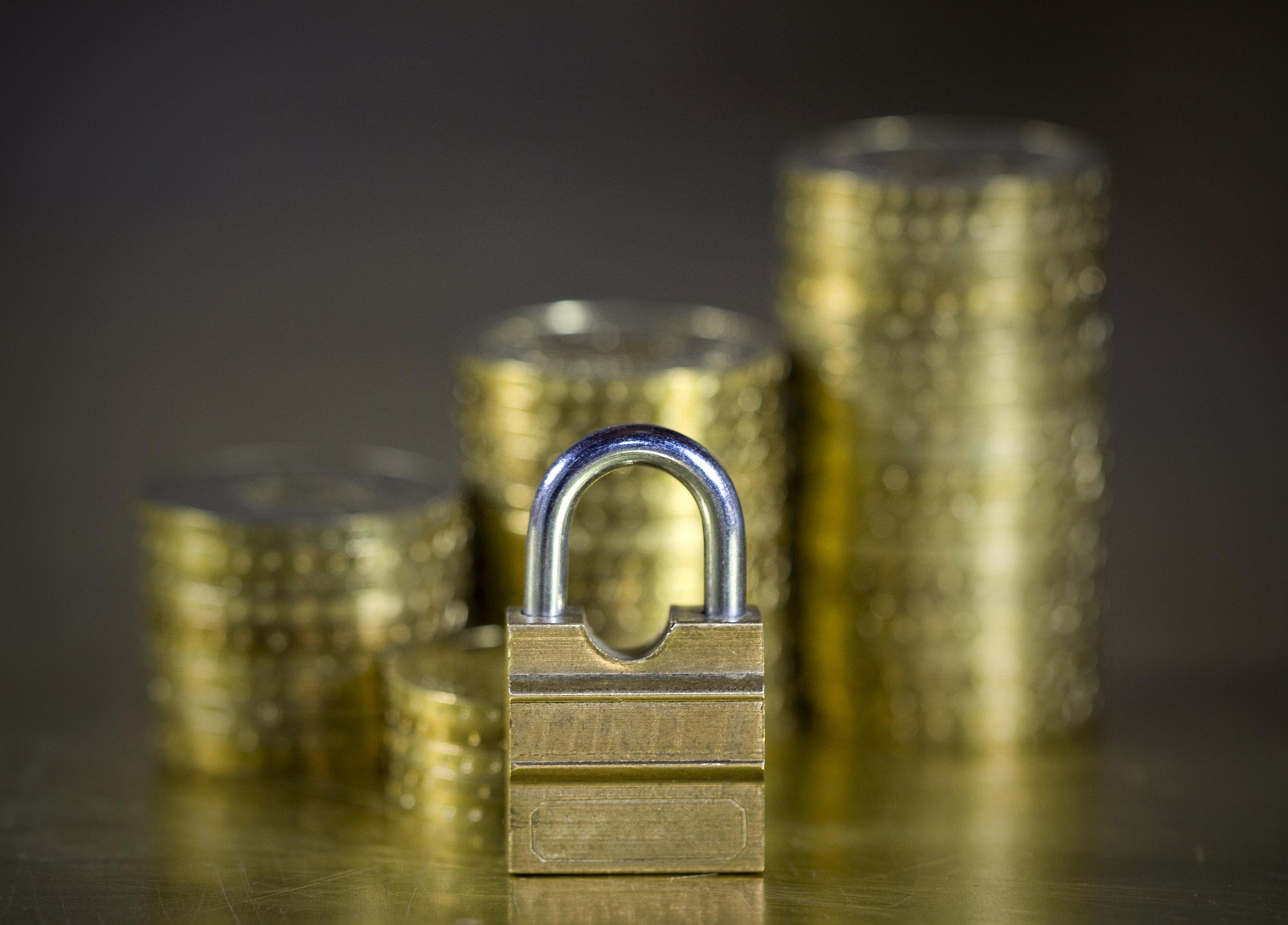 Coin stacks behind lock