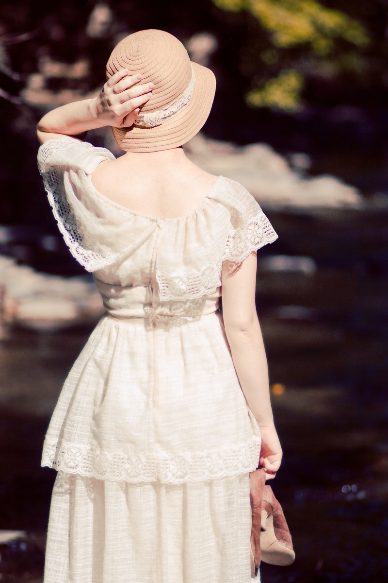 This is the original image of a woman dressed in vintage 1920's clothes by a creek.