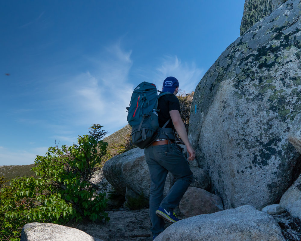 Climbing up some boulders on Abol