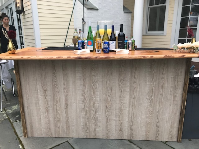 We have multiple bar tops for this base depending on your event theme. This bar is 7 feet long.