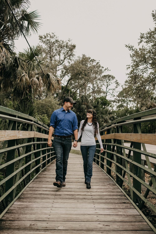 engaged couple on bridge, historic bridge