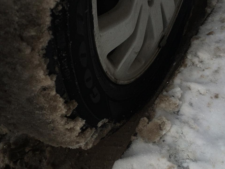 3.  This parking job –   Parallel parking isn't easy, and if you asked my dad he'd say this tire is a little too close to that curb–though something about it, shrouded in a wintry mix of ice and sleet, might make even the staunchest of parking sticklers take back any judgements.