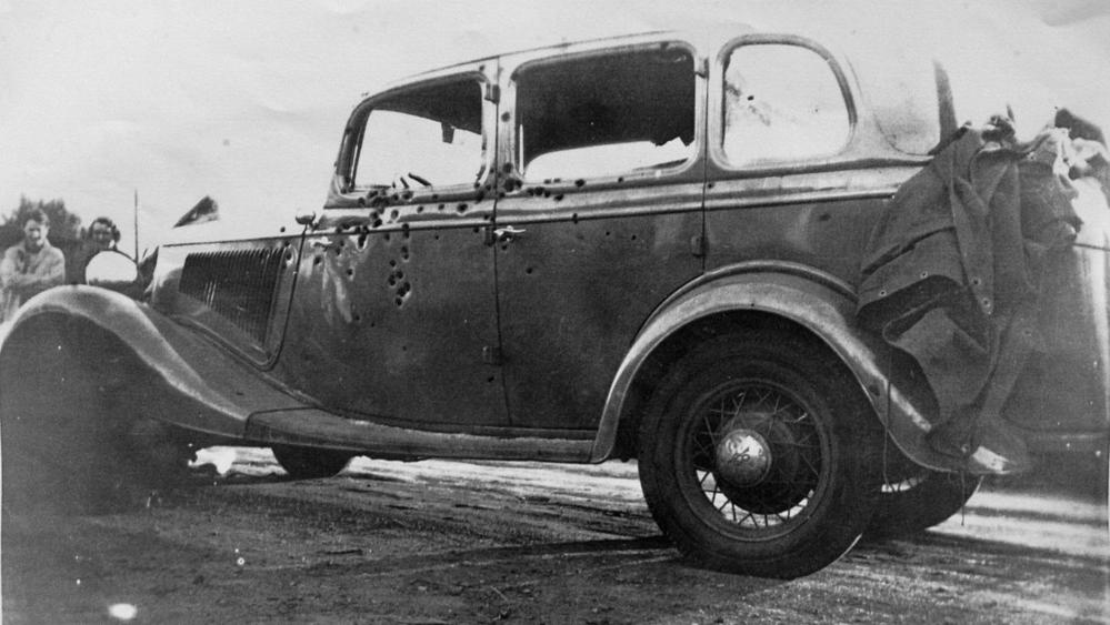 Bonnie and Clyde's car after the shootout that ended their criminal careers, and their lives. Photo by John Nowak, published in the Topeka Capital-Journal.