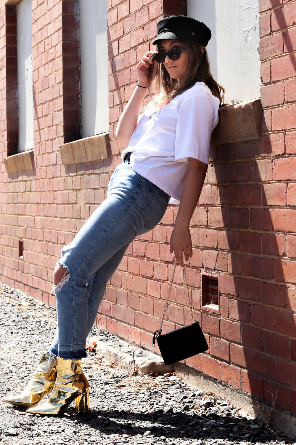 Jeans: Topshop, top: Hello Parry, belt: Gucci, bag: Oroton, shoes: Betts, sunglasses and hat: Rubi.  Model: Yasmin Cinelli
