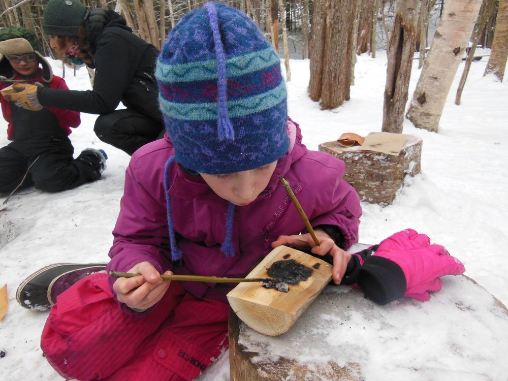 Red Foxes making coal burning bowls in the Young Naturalist program.