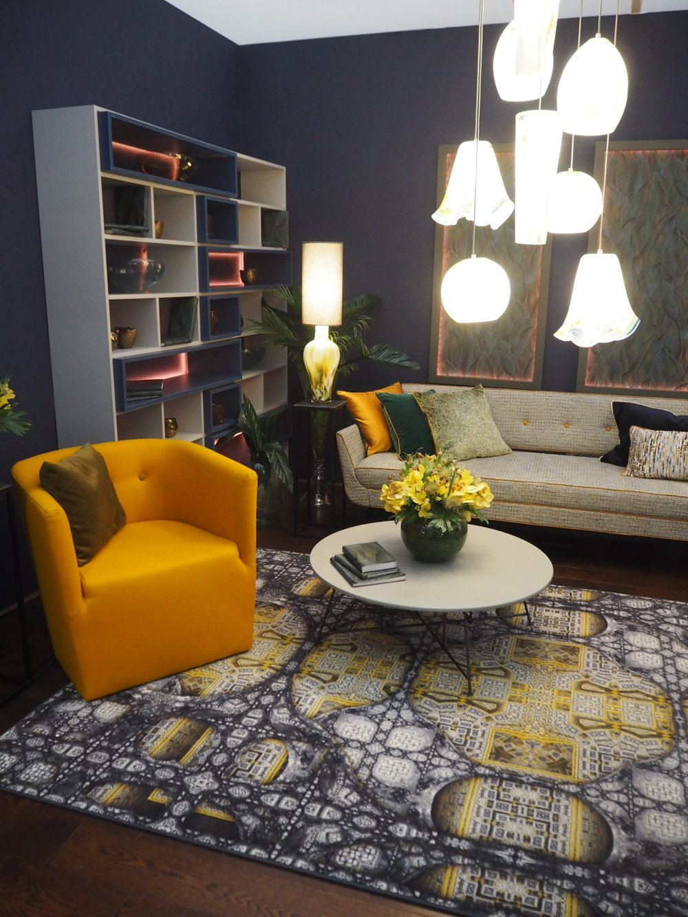 Mustard tones, with beautiful orange piping on the sofa