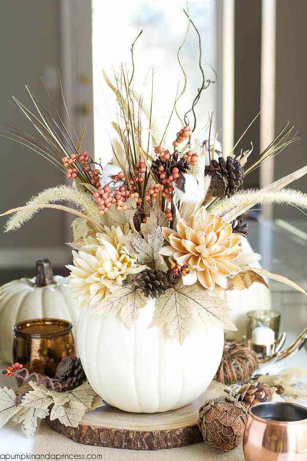 Or for a simpler effect - a pumpkin vase! - www.apumpkinandaprincess.com