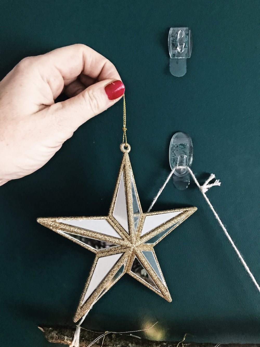 Hanging the Star to cover the string