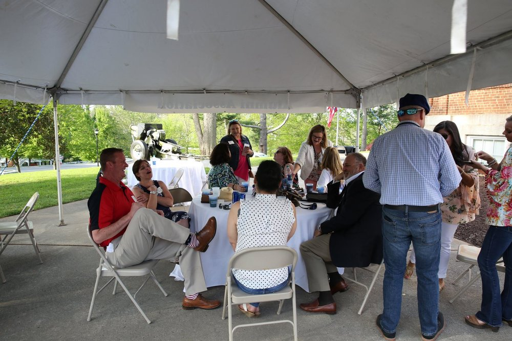 AW 2018 Mixer group at table under tent.jpg