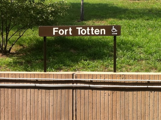 Image of a sign that reads Fort Totten, located at the Fort Totten Metro Station