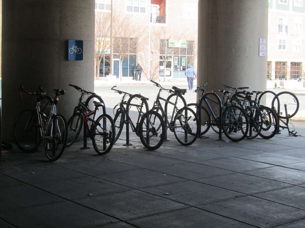 Image of bikes located at the bike rack under the underpass at the Fort Totten Metro Station