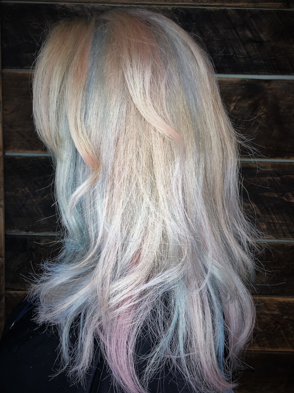 Hair By: Monica P. Watkins. Hair Babe Studio Asheville NC  Frozen Blonde With Pastel Ribbons  Cascading ribbons of baby blue, peach and pale pink add whimsy to icy blonde.