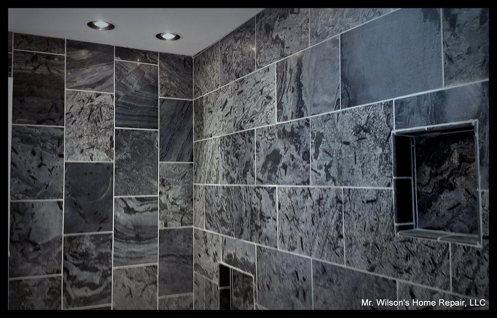 Tiling floors and walls - We remodel bathrooms and kitchens and can lay any tile of all sizes and kinds.