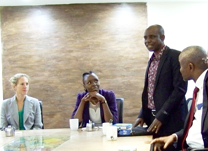 Democratic Republic of Congo Provincial Court of Appeals Judges Jonathan (standing) and Jean-Pierre (to Jonathan's right) sharing at the event for young lawyers.