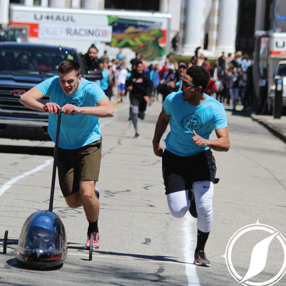 Pushers:  propelling the buggy during the uphill and horizontal portions of the course