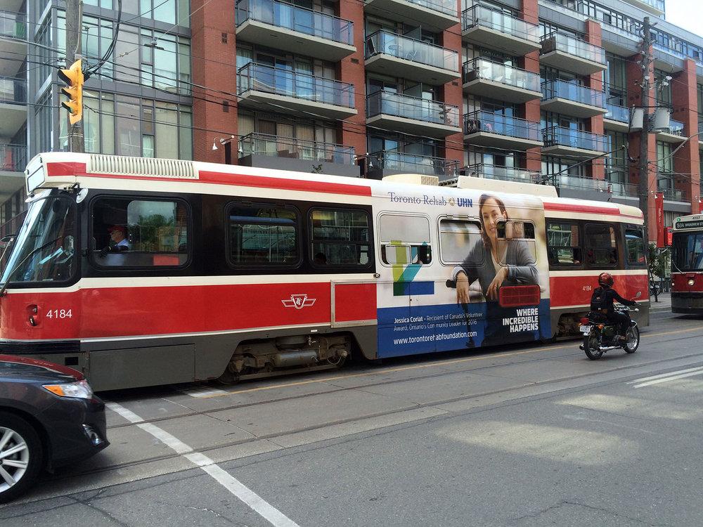 toronto-rehab-foundation-where-incredible-happens-streetcar-ad-wrap-sputnik-design-partners.jpg