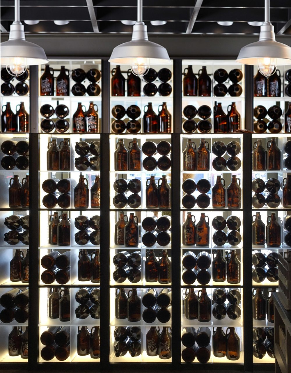 lcbo-station-growler-ads-beer-wall-sputnik-design-partners-toronto.jpg