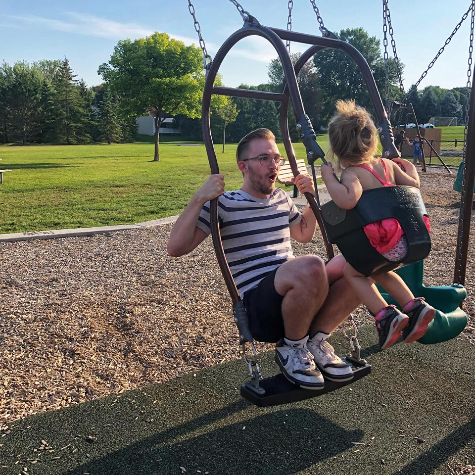 My husband and baby playing at the park.