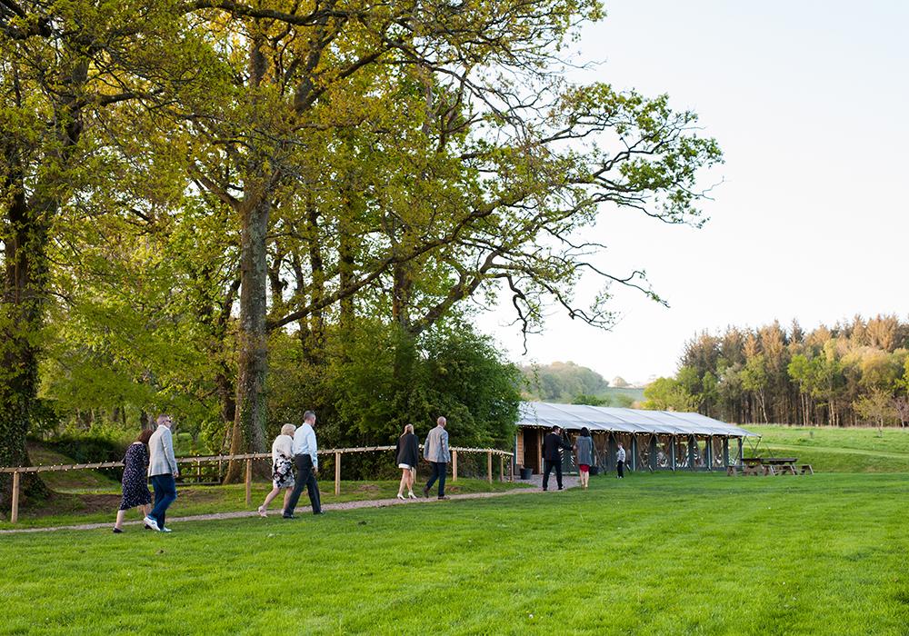 Loyton-Wedding-Walking-to-Tent.jpg