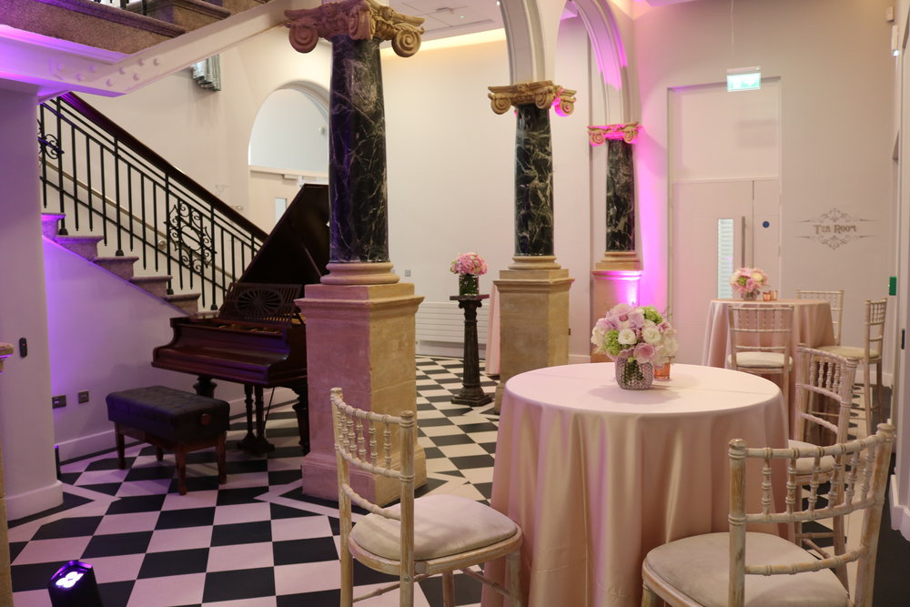 Foyer - The foyer is the ideal setting for a small welcome reception, with classic chequerboard floor tiles, marble pillars, granite staircase and complete with a baby grand piano.