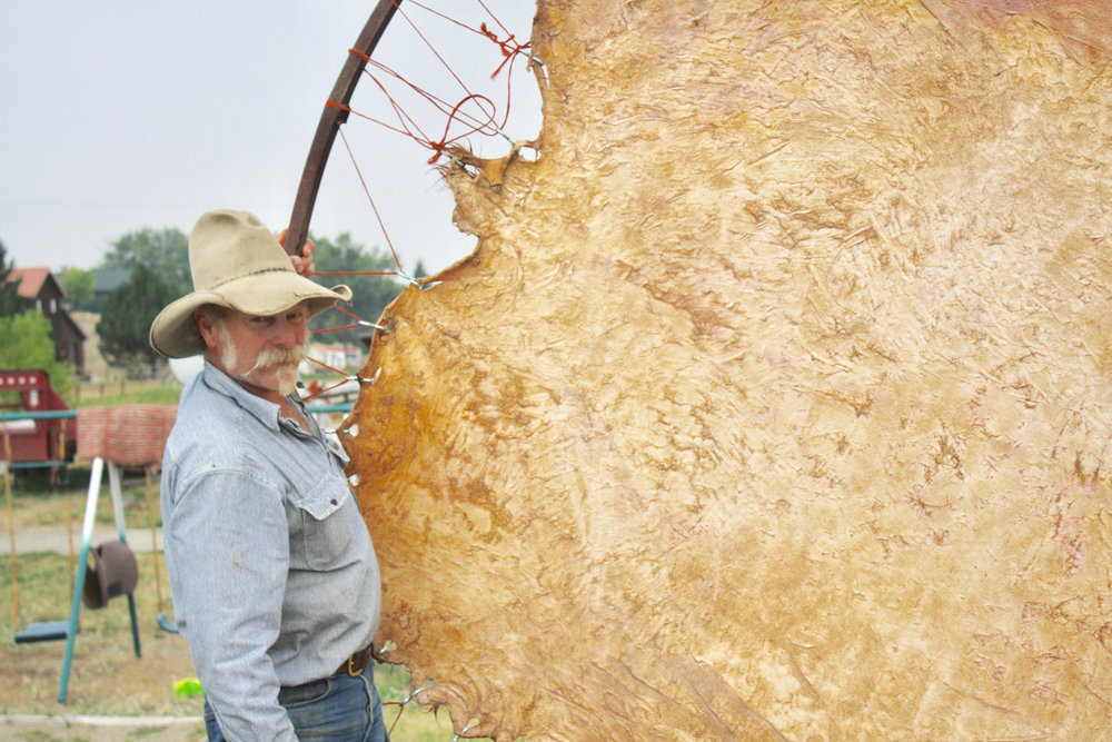 """Jeff Minor on fixing a hide: """"This is the first part, the essential part, because if you didn't have the raw material you wouldn't have the strings to work with, to braid with."""""""