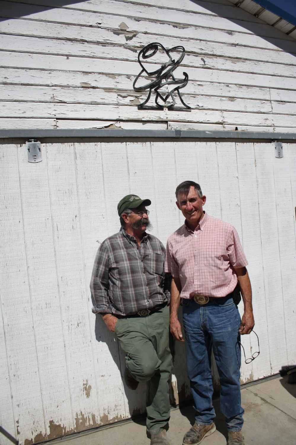 Master and apprentice outside Alderson's silversmith shop just a few miles outside of Twin Falls, Idaho.
