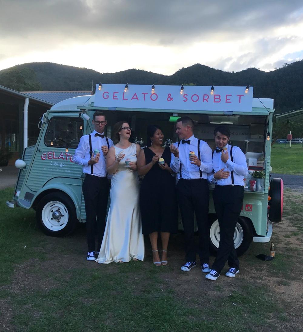 Samford Wedding Laughing Front of Van.png