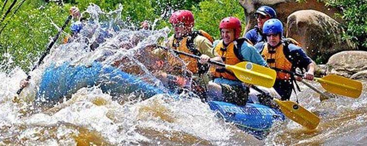 A bunch of people having a great time whitewater rafting in RVA through Riverside Outfitters.