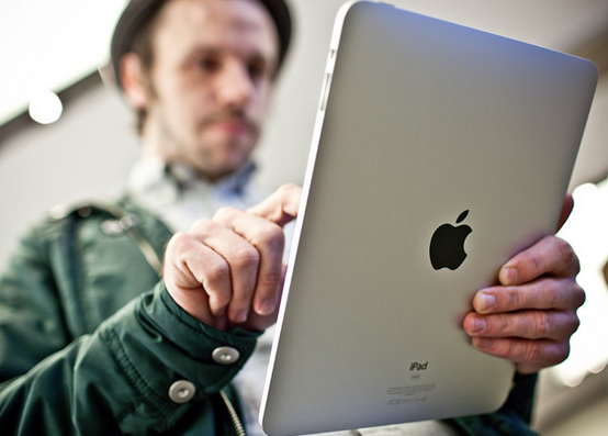 Holding-iPad.png