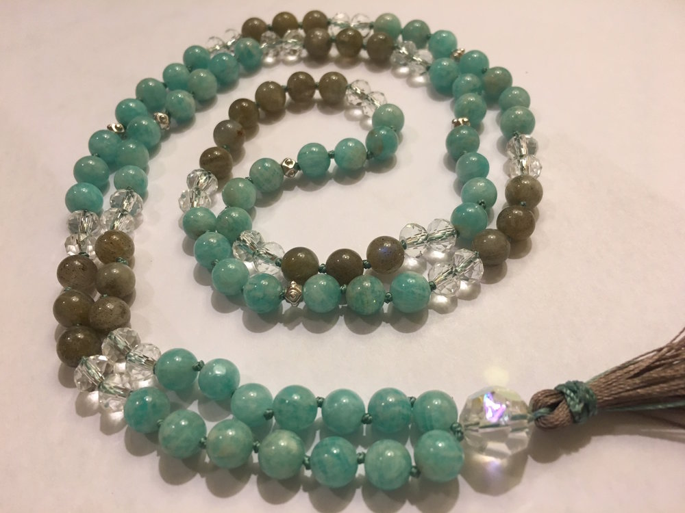"""Magic is Real   Mala  (6mm stones)  Amazonite (teal) carries soothing and calm energies, helps relieve anxiety and is known as the """"hope"""" stone. Labradorite (grey) is a stone of transformation, it allows one's innate magical powers to surface, and brings out the best in people."""