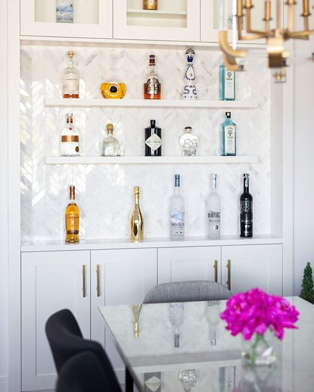 The dining room bar wall at a recent custom home built by @asanti.homes in Vancouver.  Photo: @ishot.ca  Interior Design: @studioten_interiordesign  Interior Styling: Rucku Cheema