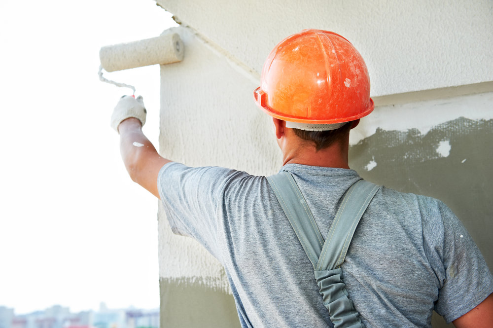 bigstock-Young-painting-facade-builder--20782691.jpg