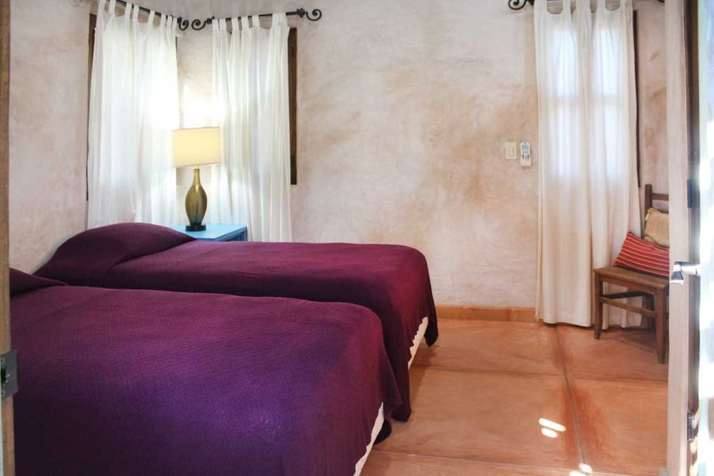 PACKAGE 2 - TRADITIONAL PRIVATE CASITA    TWIN SHARE W/ENSUITE  Features: Private Ensuite, Air Conditioning, Ceiling Fan, Private Entrance, Security Safe