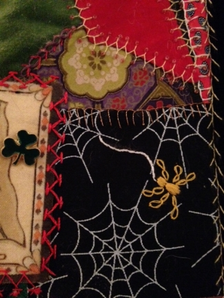 moms crazy quilt with spider