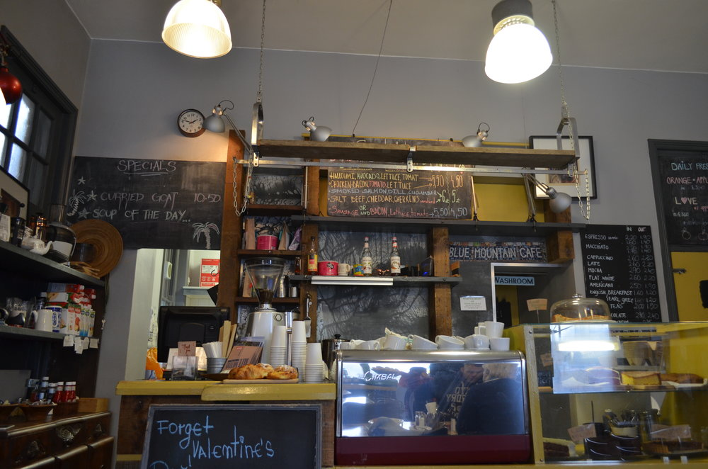 Seating - Our cafe has a warm and comfortable indoor space with a range of seating and tables for groups of any size. We also have tables in front and a small garden in the rear. Highchairs are available.